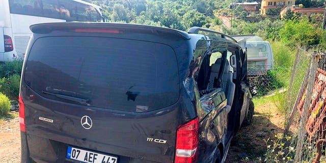 A view of the damaged vehicle involved in an accident near Alanya in Antalya province, Turkey, Monday, April 29, 2019. Czech Republic international Josef Sural was killed and six other Alanyaspor players were injured Monday when their van was involved in an accident on the way home from a Turkish league soccer match.