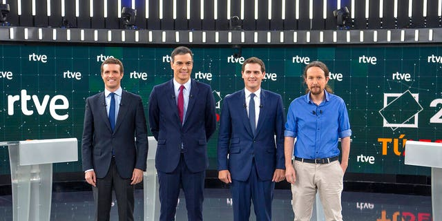 In this photo, provided by Radio Television Espanola, the four main candidates pose before a live televised general election debate in the RTVE studios in Madrid, Spain, Monday, April 22, 2019. The debate is the first of two televised debates after Spain's electoral board barred the far-right Vox party from participating because it has no presence in the country's parliament.