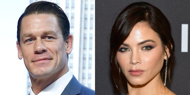 "Wrestling pro-John Cena (left) proceeded to ask Jenna Dewan if she would ever consider participating in the WWE. ""Never,"" she replied. (Getty)"