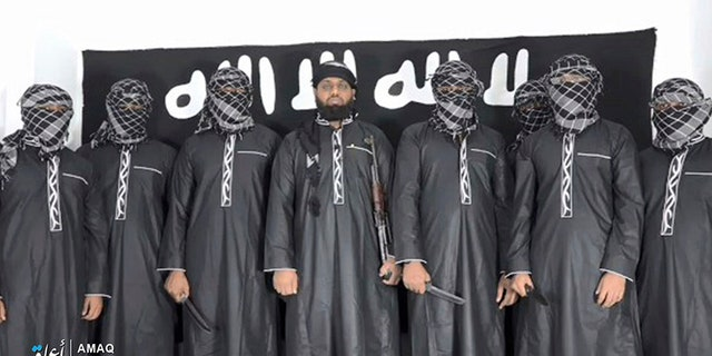 This undated image posted by the Islamic State group's Aamaq news agency on Tuesday purports to show Mohammed Zahran, a.k.a. Zahran Hashmi, center, the man Sri Lanka says led the Easter attack that killed more than 350 people, as well as other attackers.