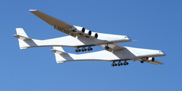 Stratolaunch, a giant six-engine aircraft with the world's longest wingspan , makes its historic first flight from the Mojave Air and Space Port in Mojave, Calif., Saturday, April 13, 2019.
