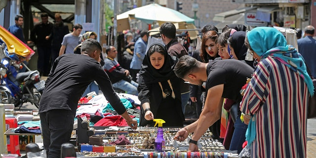 Iranians shop at an open market in the Islamic republic's capital Tehran, on April 24, 2019. - Iranians, already hard hit by punishing US economic sanctions, are bracing for more pain after Washington abolished waivers for some countries which had allowed them to buy oil from Iran.
