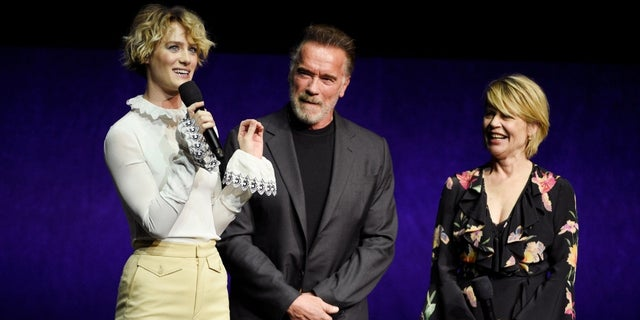 "Mackenzie Davis, left, a cast member in the upcoming film ""Terminator: Dark Fate,"" talks about the film as fellow cast members Arnold Schwarzenegger, center, and Linda Hamilton look on."