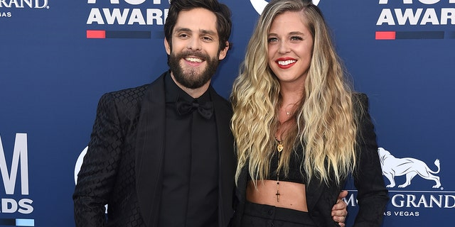 Thomas Rhett, left, and Lauren Akins arrive at the 54th annual Academy of Country Music Awards at the MGM Grand Garden Arena on Sunday, April 7, 2019, in Las Vegas. (Photo by Jordan Strauss/Invision/AP)