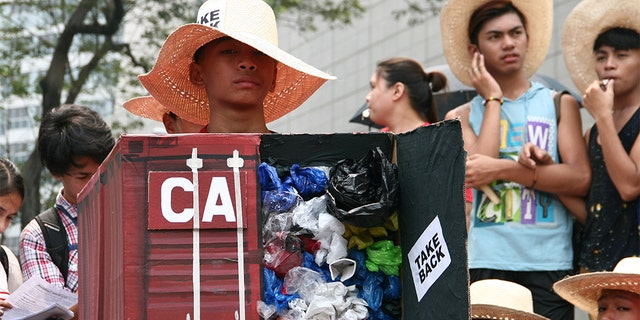 Environmental activists protesting the tons of garbage Canada shipped to the Philippines in front of the Canadian Embassy in Makati in 2015.<br data-cke-eol=&quot;1&quot;>&#8220;></picture></div> <div class=