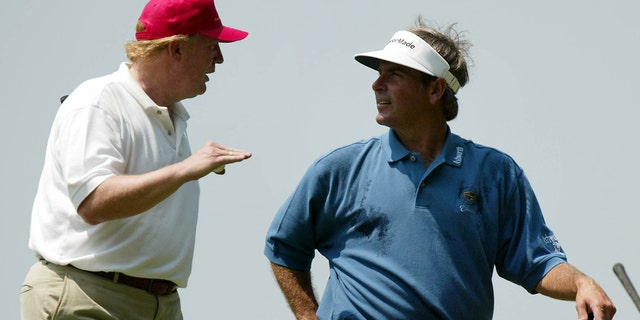 Donald Trump, left, talks with Fred Couples as they leave the 14th hole of the Buick Classic Pro-Am golf tournament in Harrison, NY, Wednesday, June 9, 2004.