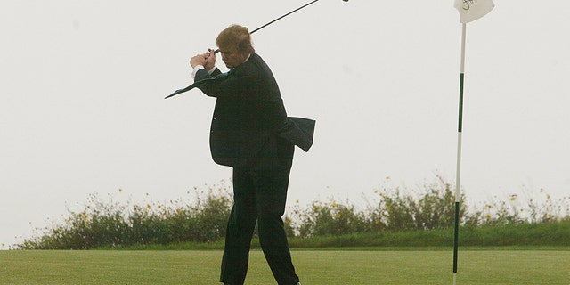 Donald Trump takes a swing on the 11th green of his newly acquired Ocean Trails Golf Club in Rancho Palos Verdes, Calif., Saturday, Nov. 9, 2002.