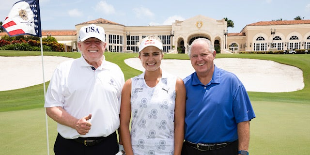 President Trump poses with professional golfer Lexi Thompson and radio host Rush Limbaugh on Friday, April 19, 2019.