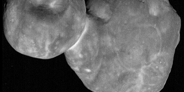 The distant object Ultima Thule, as seen by NASA's New Horizon spacecraft on January 1, 2019. In this view, are mysterious hill-like features clearly visible on the larger lobe of the body.