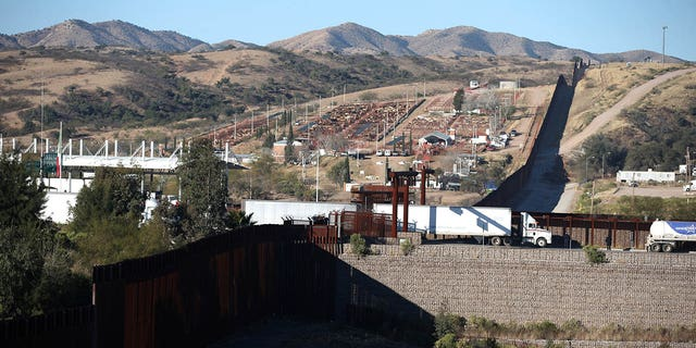 Trucks cross the border from Mexico into the U.S. in Nogales, Arizona, U.S., January 31, 2017. Picture taken January 31, 2017.