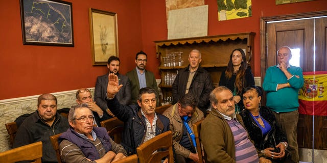 In this April 10, 2019 photo, farmers attend a meeting with Spanish far right party Vox at a bar in Brazatortas, on the edge of the Alcudia valley, central Spain. The April 28 election also comes as Spain's traditional bipartisan politics have crumbled into five main contenders, spurring the race for votes in the overrepresented hinterland, where nearly one third of seats in the parliament's lower house are up for grabs.