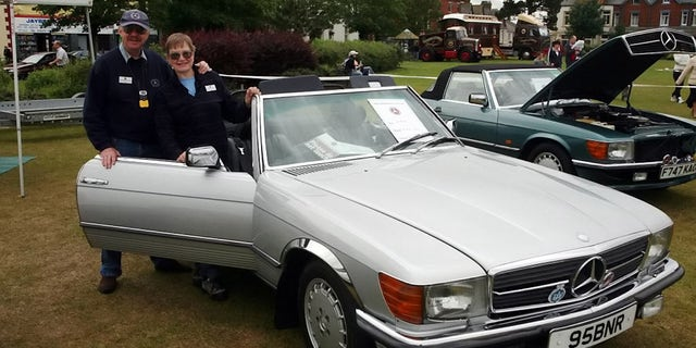William Reid and Kathryn Workman were putting theirMercedes-Benz convertible away for the winter.