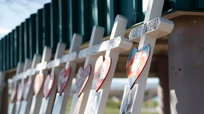 Columbine memorial ceremony shines a light on community strength: a 'senseless tragedy indelibly imprinted ...