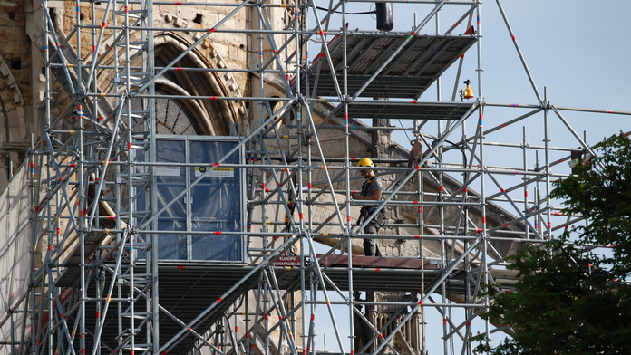 The Latest: Fire chief: Team effort to save Notre Dame relic