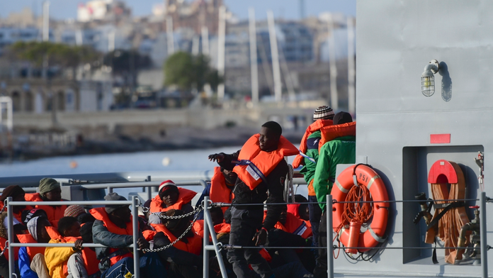 The Latest: Granted asylum requests dropped in EU in 2018