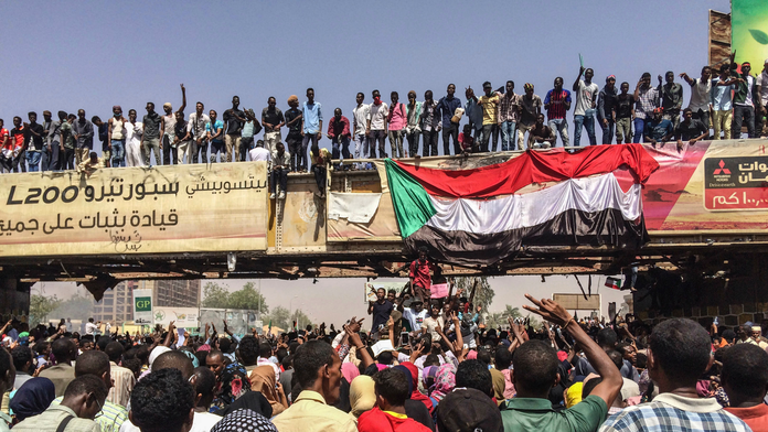 The Latest: Sudan army deploys in capital amid coup rumors