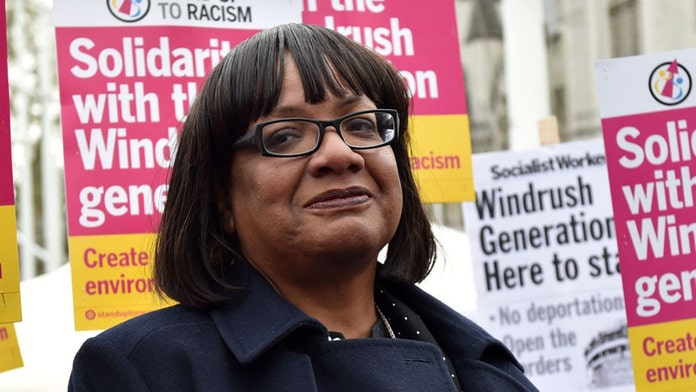 Senior British politician Diane Abbott apologizes after photo captures her drinking on train