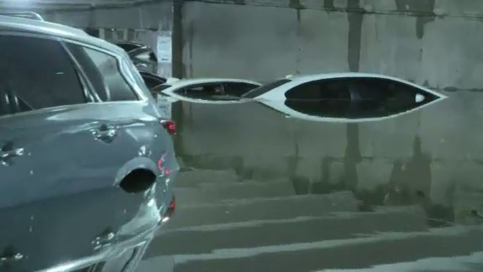 Garage floods at Dallas Love Field amid heavy rains, leaves dozens of cars partially submerged