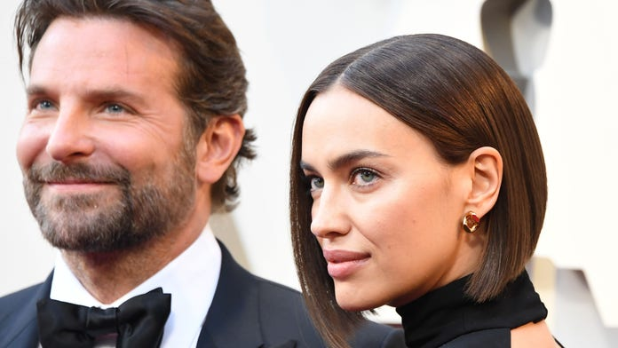 Bradley Cooper, Irina Shayk and daughter photo-bomb 'Ex on the Beach' stars while walking their dogs
