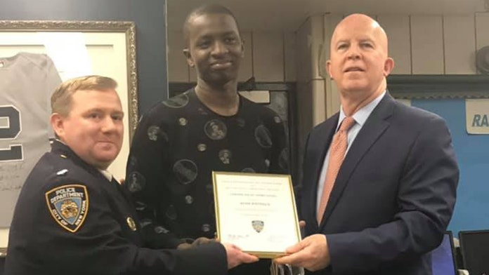 Domino's 'superhero' delivery man who chased down thief honored by NYPD