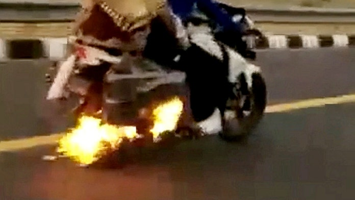 Police save family aboard flaming motorcycle