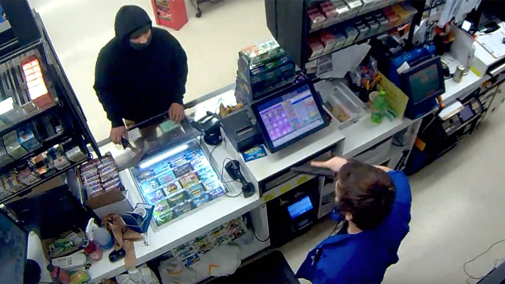 Store clerk with gun scares off ax-wielding thief, loses job