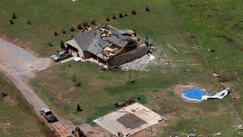 Dozens of tornados slam Midwest as floodwaters rise; at least 2 dead