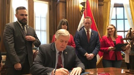 Missouri governor signs bill banning abortions at 8 weeks