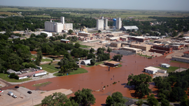 The Latest: River erosion threatens Oklahoma homes