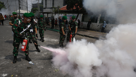 The Latest: Social media blocked due to Indonesia protests