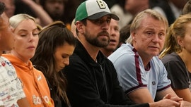 Milwaukee Bucks fan buys Danica Patrick's drink in front of Aaron Rodgers during playoff game