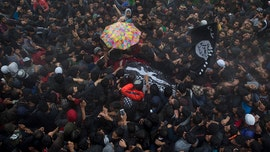 Thousands mourn Al Qaeda-linked terrorist - dubbed 'India's most wanted' militant - killed in Kashmir