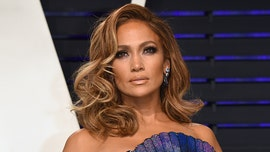 Jennifer Lopez breaks out iconic Versace dress for 'SNL': 'Some people say I look better now'