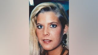 Twin sister's billboards drawing new attention to woman's unsolved 1996 murder