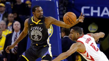 Rockets fan heckles Warriors' Kevin Durant 'New York Knicks!' during Game 4