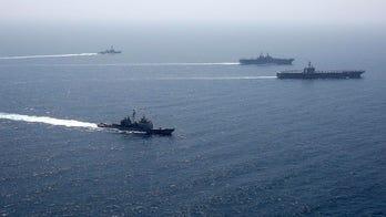 Large US warships train together in Arabian Sea with eye on Iran threats, Navy says