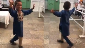 Afghan boy, 5, does happy dance with new prosthetic leg