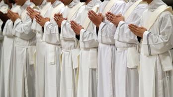 Pope ordaining 19 men to priesthood in St. Peter's Basilica
