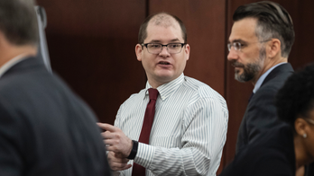 The Latest: Defense focuses on defendant's odd confession