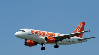 Easyjet passengers cheer as 'aggressive' couple is removed from flight