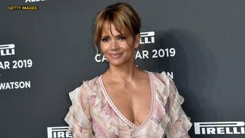 Halle Berry explains massive back tattoo, defends cooking topless: 'I do it all the time'