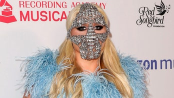 Kesha wears bizarre crystal mask reminiscent of Hannibal Lecter to MusiCares concert