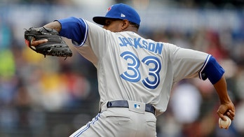 Jackson plays for record 14th team, Blue Jays lose to Giants