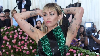 Miley Cyrus poses topless as she gets ready for the 2019 Met Gala