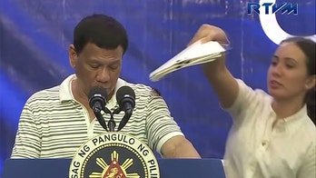 Philippines' Duterte bugged by massive cockroach during campaign rally before joking: 'It's a liberal!'