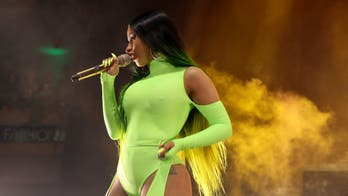 Cardi B wows in tight yellow outfit at Fashion Nova party performance