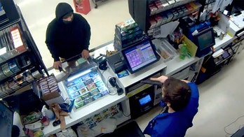 Hatchet-wielding thief backs down when store clerk pulls out gun - but firearm costs employee his job