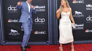 Camille Kostek, Rob Gronkowski goof off on Billboard Music Awards red carpet