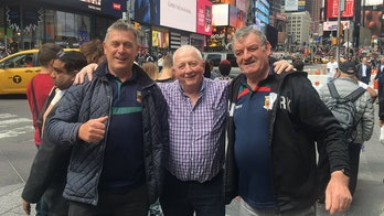 Photographer finds Times Square tourists in viral image through 'power of social media'