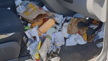 Driver fined, license suspended for 'dangerous' amount of fast-food wrappers in car